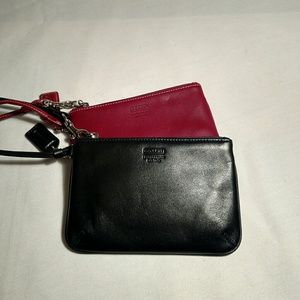 Two Coach leather wristlets - black and red